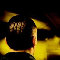 Point S - Kopf mit Reifenprofil Haarschnitt